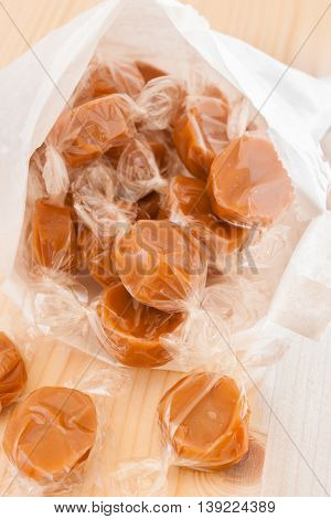 Wrapped toffee pieces in a paper sweet bag