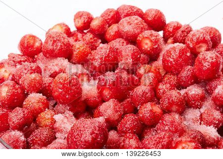Fresh ripe strawberries with sugar on a white background