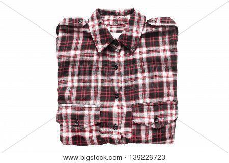 Folded tartan shirt isolated on white background