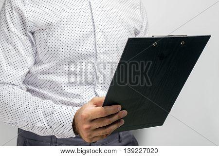 Businessman Holding A Clipboard