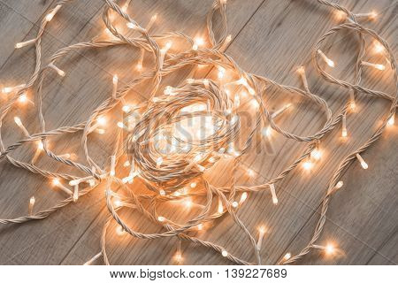 Decorative flash lights on wooden floor as a background