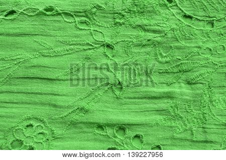 Green embroidered cloth closeup as a background