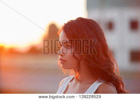 Beauty Sunshine Girl Portrait. Sunny Summer Day under the Hot Sun.