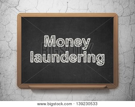 Currency concept: text Money Laundering on Black chalkboard on grunge wall background, 3D rendering