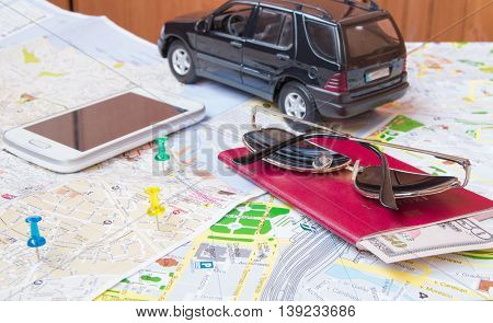 Plan your journey by car a passport money cards phone sunglasses.
