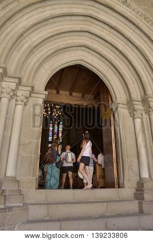 GUIMARAES, PORTUGAL - AUGUST 9, 2016: Entrance to the chapel inside the Palace of the Dukes of Braganza in Guimaraes in the northern region of Portugal