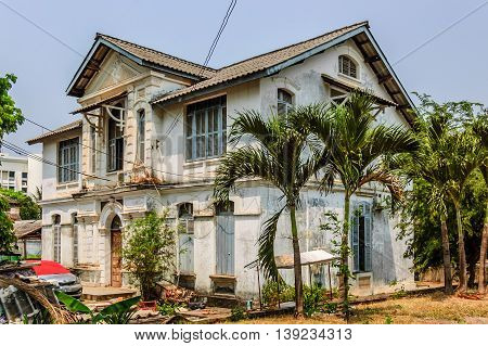 Vientiane Laos - March 16 2013: Derelict house in Vientiane the capital of Laos