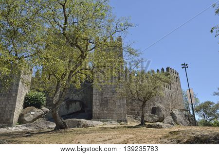 GUIMARAES, PORTUGAL - AUGUST 9, 2016: Perspective of the Castle of Guimaraes in the northern region of Portugal. It was built at the end of the 13th century following French influences.