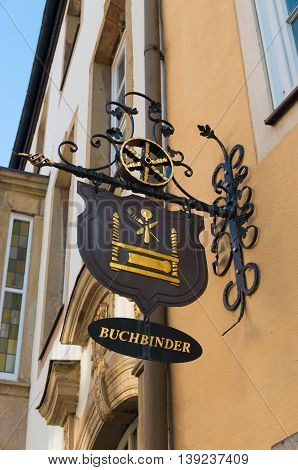 OSNABRUECK, GERMANY - NOVEMBER 1, 2015: Buchbinder (bookbinder) sign board on the facade of a house