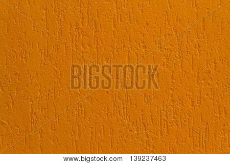 Bright orange stucco wall. Backgrounds and textures