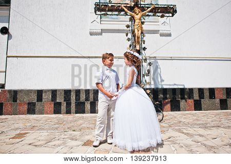 Brother And Sister At First Holy Communion Background Church Cross