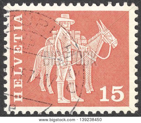 MOSCOW RUSSIA - CIRCA JANUARY 2016: a post stamp printed in SWITZERLAND shows a mounted postman and a pack animal the series