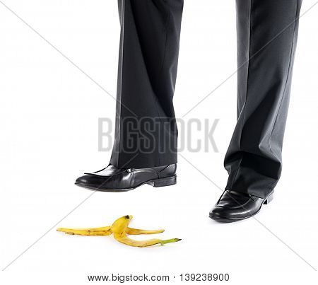 Man about to step on banana peel isolated on white background.