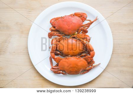 Hot Steamed black Crabs in white dish