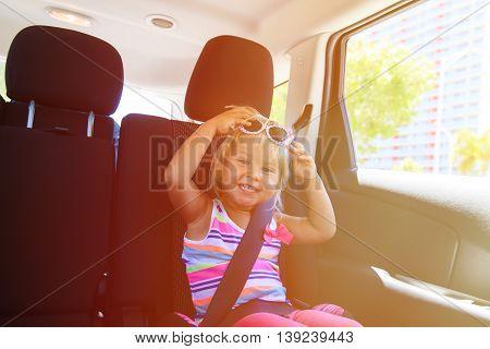 cute little girl enjoy travel by car in city