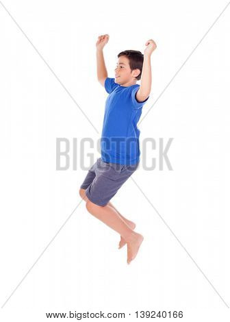 Happy child jumping isolated on a white background