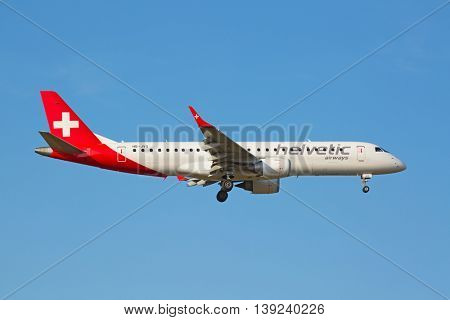 ZURICH - JULY 18: Helvetic airways landing in Zurich airport on July 18, 2015 in Zurich, Switzerland. Zurich airport is home port for Swiss Air and several budget airlines.