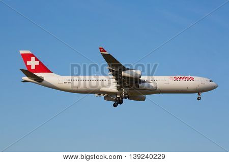 ZURICH - JULY 18: Swiss A-340 landing in Zurich airport after intercontinental flight on July 18, 2015 in Zurich, Switzerland. Zurich airport is one of the biggest european hubs.
