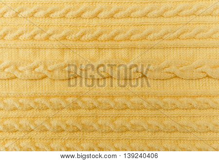 Yellow Knitted Background with Pattern and Braids.Hand Made;Fancywork.