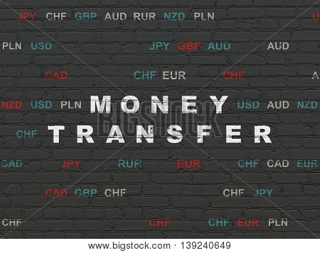 Finance concept: Painted white text Money Transfer on Black Brick wall background with Currency