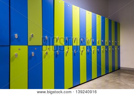 Locker, clothes locker in a gym or sports center.