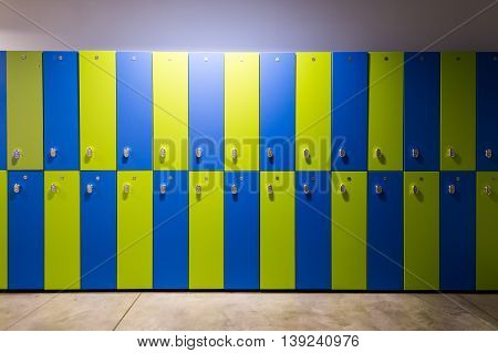 Photo Of Blue and green Lockers In The gym.