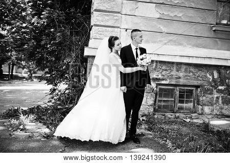 newlyweds background old house at wedding day