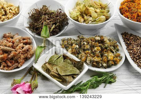 Natural flower and herb selection in ceramic bowls, close up