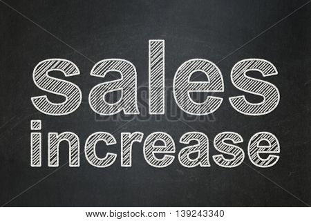 Marketing concept: text Sales Increase on Black chalkboard background