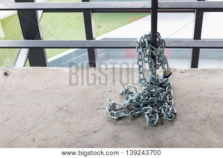 padlock on the chain with protector in home.