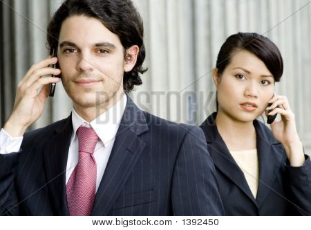 Smiling Businessman And Woman