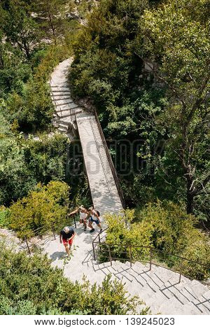 People Travelling, Walking On Stone Steps Trail, Path, Way, Mountain Road In Verdon Gorge In France. Scenic View