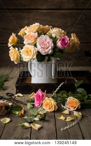 A vase full of roses on a serving tray