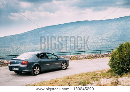 Verdon, France - June 29, 2015: Peugeot 407 car on background of French mountain nature landscape. The Peugeot 407 is a large family car produced by the French automaker Peugeot from 2004 to 2010.