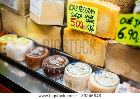 Malaga, Spain - June 22, 2015: Cheeses on local farmers grocery market.
