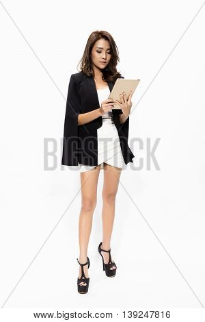 full length business woman using touch pad tablet pc isolated on white background model is a asian beautiful