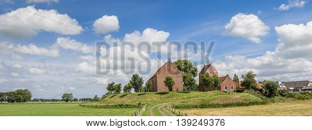 Panorama of medieval church of the Groningen village Ezinge in The Netherlands