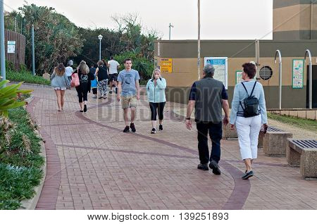 DURBAN SOUTH AFRICA - JULY 13 2016: Locals and tourists at Bronze Beach on the Umhlanga Rocks promenade