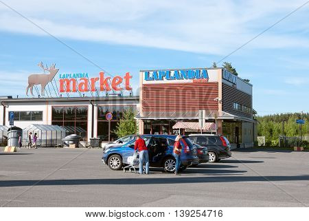 LAPPEENRANTA, FINLAND - JUNE 15, 2016: Laplandia Market near Finnish-Russian border. People put purchases into the car