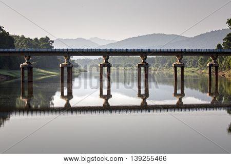Reflection of a Bridge in a river at Thattekkad Bird Sanctuary near Kochi, Kerala, India
