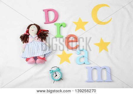Sleep concept with accessories on color background