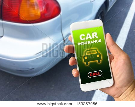 Woman hand holding smartphone against scratched car background with word car insurance call