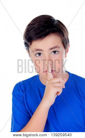 Little boy with ten years old indicating silence isolated on a white background