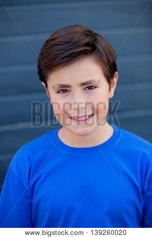 Funny child with ten years old with blue t-shirt outside
