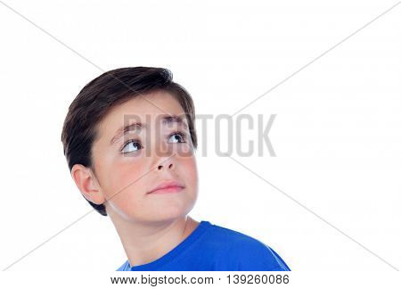 Funny child with ten years old and blue t-shirt looking up isolated on a white background