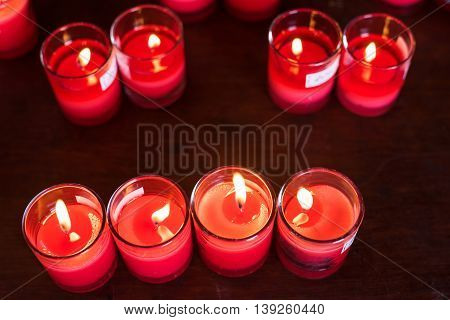 Many burned red candles by top view in Chinese temple to get healthy wealthy and luck.