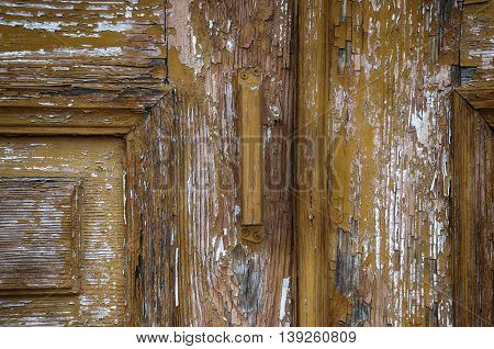 Fragment of old brown door with the door handle