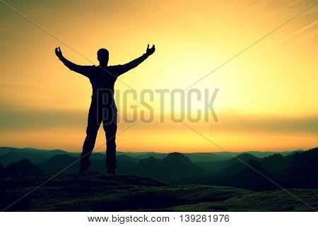 Happy Man With Open Raised Arms Gesture Of Triumph. Satisfy Hiker  Silhouette