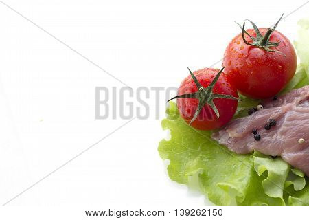 piece of raw meat and vegetables isolated on white background