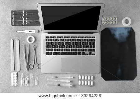Medical tools set with laptop on gray background
